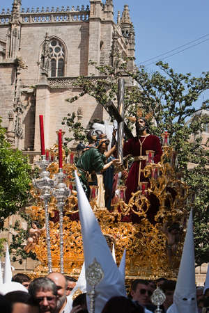 sacramental: Sacramental brotherhood of Se�or San Sebasti�n and Penitents Brotherhood of our father Jesus de la Victoria, during Holy Week, Sevilla, Andalusia, Spain