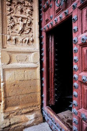 lintel: Entrance wooden door to the chapel of El Salvador, lintel carved stone, renaissance style, Ubeda, Jaen province, Spain Stock Photo