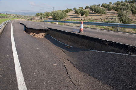 pot hole: Asphalt road with a crack caused by landslides, Ja�n, autonomous community of Andalusia, Spain Stock Photo