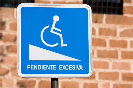excessive: sign of notice for handicapped persons, excessive slope, Spain Stock Photo