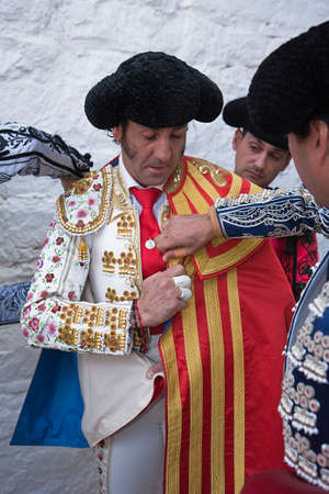 padilla: The spanish bullfighter Juan Jose Padilla  getting dressed for the paseillo or initial parade  Taken at Andujar bullring before a bullfight, Andujar, Jaen province, Spain, 24 september 2010 Editorial