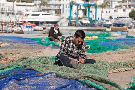 Sailor fixed their fishing nets in the port of Estepona, province of malaga, Spain