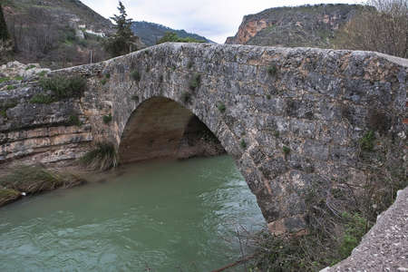 The bridge and the Roman road of Colomera are in very good state of conservation  Located outside the urban core, can be referred to in the place known as Mill of the Bridge  Invoice of the good faith of the bridge gives the fact that until recently this Stock Photo - 23663246