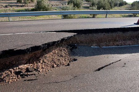no integrity: Asphalt road with a crack caused by landslides, Ja�n, autonomous community of Andalusia, Spain Stock Photo