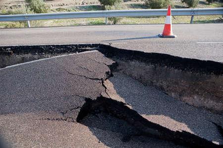 Asphalt road with a crack caused by landslides, JaŽn, autonomous community of Andalusia, Spain Banco de Imagens