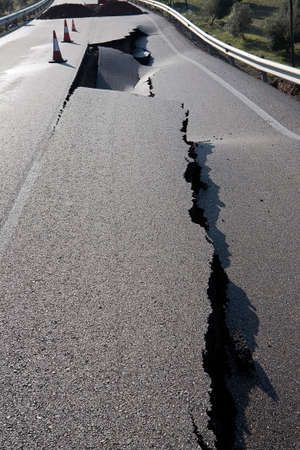 Asphalt road with a crack caused by landslides