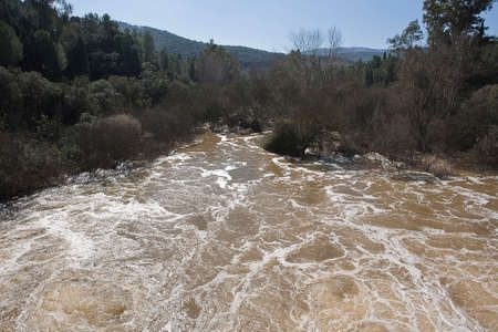 expulsion: Expulsion of water after heavy rains in the reservoir of Puente Nuevo River Guadiato, near Cordoba, Andalusia, Spain Stock Photo