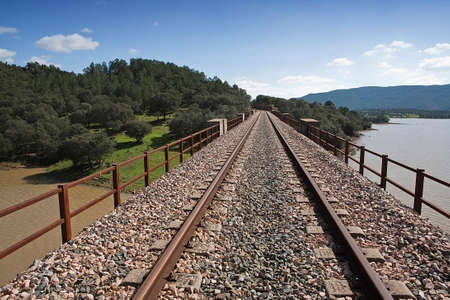 nuevo: Abandoned railway line from C�rdoba to Almorch�n, municipality of Espiel, Embalse de Puente Nuevo, near C�rdoba, Spain Stock Photo