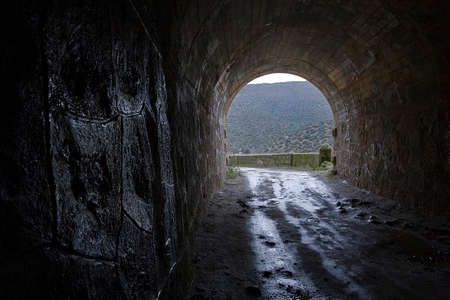 Reservoir Jandula, tunnel excavated in the mountain of granite and slate in the reservoir of Jandula, Jaen, Spain photo