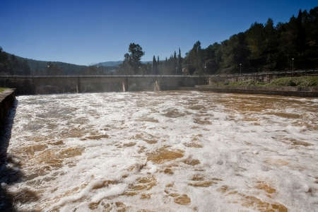 expulsion: Expulsion of water after heavy rains in the embalse de Puente Nuevo, near Cordoba, Andalusia, Spain Stock Photo