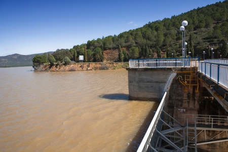 expulsion: Expulsion of water after heavy rains in the reservoir of Puente Nuevo to river Guadiato, near Cordoba, Andalusia, Spain
