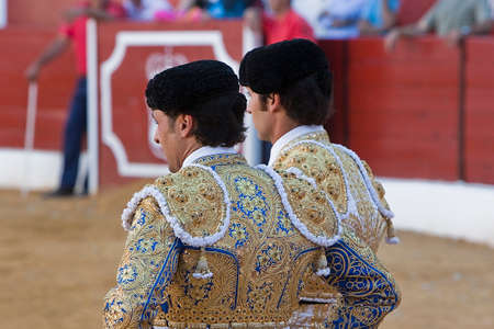 bullfighters: Spanish Bullfighters Francisco Rivera and Cayetano Rivera with the Cape in the Bullfight, Villanueva del arzobispo, Jaen province, Spain, 9 september 2011