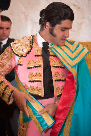 capote: The spanish bullfighter Morante de la Puebla getting dressed for the paseillo or initial parade  Taken at Andujar bullring before a bullfight, Andujar, Jaenprovince, Spain, 11 september 2009 Editorial