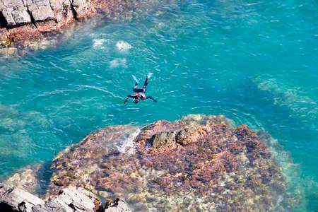 Scuba diver on the surface of the sea, Almu�ecar, Granada province, Spain photo