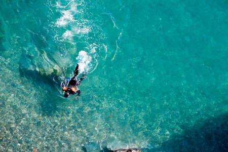 Scuba diver on the surface of the sea, Almuñecar, Granada province, Spain photo