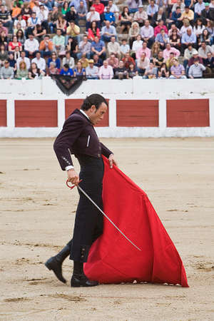 The Spanish Bullfighter Finito de Cordoba bullfighting with the crutch in the Bullring of the Linares, JaŽn, Spain, 15 march 2009