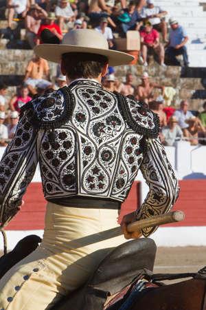 weaken: Picador bullfighter, lancer whose job it is to weaken bulls neck muscles, Spain