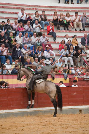 Alvaro Montes, bullfighter on horseback spanish giving the spectators, Coso de la Alameda, Jaen, Spain, 13 october2008