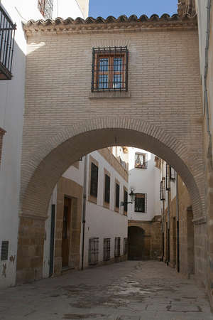 characterized: Typical Street of the world heritage city in Baeza, Street Barbacana next to the clock tower, It is characterized by the union of two houses with a passage, Baeza, Jaen province, Andalucia, Spain