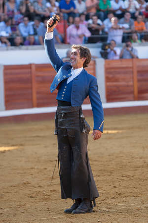 right handed: Pozoblanco, Cordoba province, SPAIN- 25 september 2011  Spanish bullfighter on horseback Pablo Hermoso de Mendoza thank the trophy which has been awarded the President of bullring, an ear in his right hand in Pozoblanco, Cordoba province, Andalusia, Spain