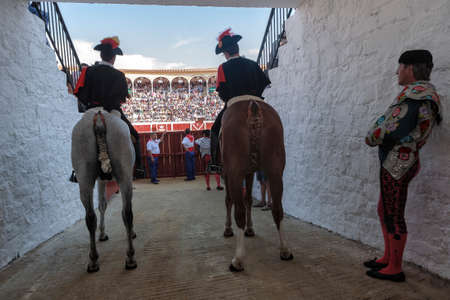 bullfight on horseback: Pozoblanco, Cordoba province, SPAIN - 25 september 2011  Alguaciles on horseback iin the alleywaiting for the order to open the door from the Bullring to start the show, in Pozoblanco, Cordoba province, Andalusia, Spain