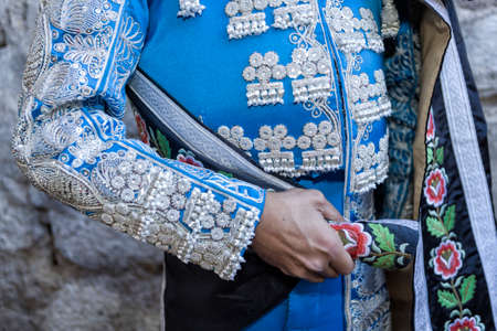 bullfighter: Ubeda, Jaen province, SPAIN - 29 september 2010  Spanish Bullfighter with blue dress and silver ornaments, the mantle is placed to start the paseíllo before beginning the bullfighting in Ubeda, Jaen provincia, Andalusia, Spain