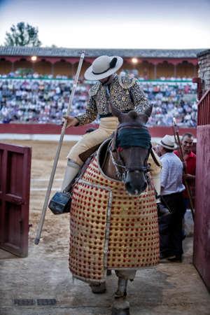 weaken: Baeza, Jaen province, SPAIN - 15 august 2010  Picador bullfighter, lancer whose job it is to weaken bull