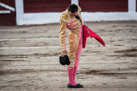 Linares, Jaen province, SPAIN - 28 august 2011  Spanish bullfighter Manuel Jesus El Cid drops his hat on the ground, it is a very old tradition, given that if the hat falls down you give luck to the Bullfighter in his work during a bullfight held in Linar Editöryel