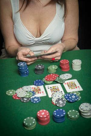 Very beautiful woman playing texas hold photo