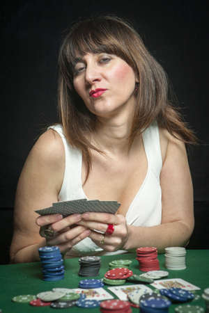 Attractive woman playing texas holdem poker  photo