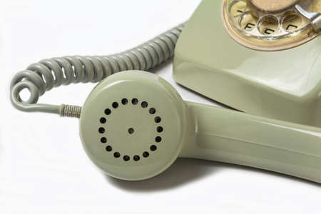 Vintage telephone receiver isolated on white  photo