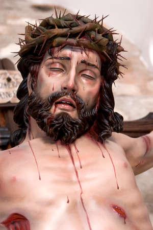 Figure of Jesus on the cross carved in wood by the sculptor José Miguel Tirao Carpio, Cristo de las Lluvias, Mengibar, Jaen province, Spain photo