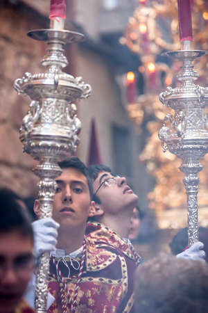 collectivity: Acolytes with Dalmatian garb support candlesticks during a pretransfer of healthy week, Spain
