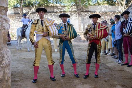 bullfighters: Baeza, Jaen province, SPAIN - 14 august 2014: Bullfighters Jimenez Fortes, Javier Casta�o and Antonio Ferrera at the paseillo or initial parade Bullfight at Baeza bullring, Baeza, Jaen province, Andalusia, Spain Editorial