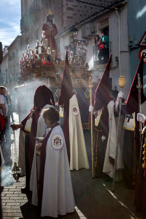 Shadows of penitents on Holy week procession, Spain