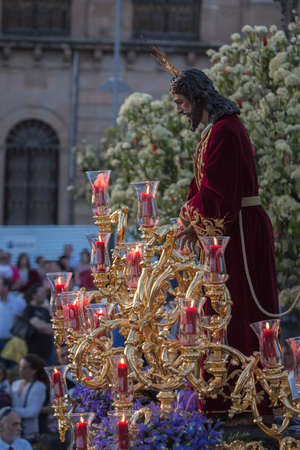 collectivity: Brotherhood of Jesus corsage making station of penitence in front at the town hall, Linares, Jaen province, Andalusia, Spain Editorial