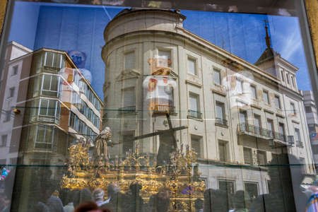 collectivity: Reflection in a window of Holy week in the good Friday procession, Spain Stock Photo