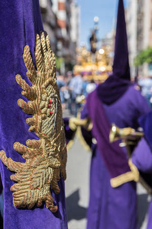 collectivity: Detail of embroidery and tassel in a Purple banner, traditional dress of holy week in Spain