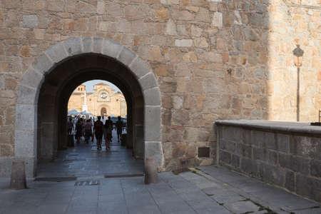 san pedro: Avila, SPAIN - 10 august 2015: Santa Teresa Square, Front of the Church of San Pedro, Tourists strolling through the arc of the walls of Avila, Spain