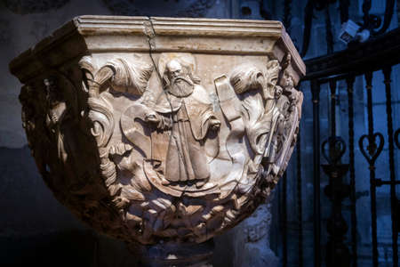 plateresque: Avila, SPAIN - 10 august 2015: Detail Baptismal Chapel of the cathedral of Avila, inside a space closed by a plateresque grill attributed to Juan Francs, Work of Vasco de la Zarza foot and exedra, 1514, Centuries XIV-XV, Avila, Spain