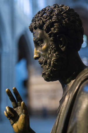 the distinguished: Avila, SPAIN - 10 august 2015: Sculpture in bronze of St. Peter enthroned, is distinguished by having key on left arm, unknown author, Cathedral of vila, Spain