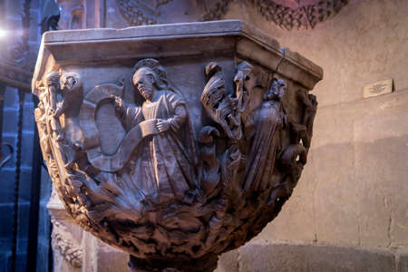 plateresque: Avila, SPAIN - 10 august 2015: Baptismal Chapel of the cathedral of Avila, inside a space closed by a plateresque grill attributed to Juan Francs, Work of Vasco de la Zarza foot and exedra, 1514, Centuries XIV-XV, Avila, Spain