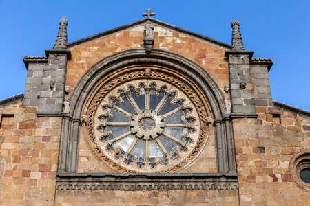 san pedro: Avila, SPAIN - 10 august 2015: Santa Teresa Square, Front of the Church of San Pedro, main facade stands out its Cistercian rosette, Avila, Spain Editorial