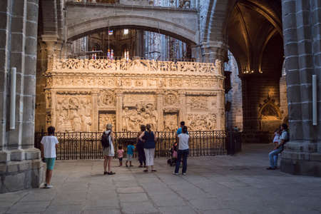 go inside: Avila, SPAIN - 10 august 2015: Inside view of the Cathedral in Avila, Group of tourists admiring the retrochoir illuminated, a Romanesque and Gothic church in the South of Old Castile in Spain, considered by its age 12th century as one of the first two Go
