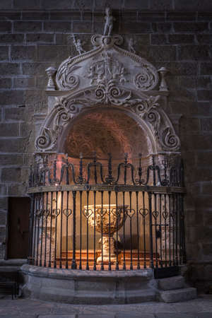 attributed: Avila, SPAIN - 10 august 2015: Baptismal Chapel of the cathedral of Avila, inside a space closed by a plateresque grill attributed to Juan Francs, Work of Vasco de la Zarza foot and exedra, 1514, Centuries XIV-XV, Avila, Spain