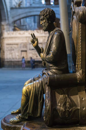 st  peter: Avila, SPAIN - 10 august 2015: Sculpture in bronze of St. Peter enthroned, is distinguished by having key on left arm, unknown author, Cathedral of vila, Spain
