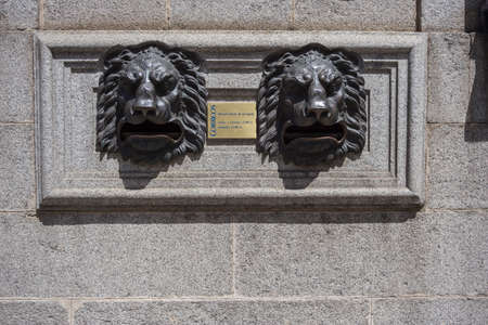 nouse: Post Office Building, detail of mailbox for letters with lion heads made in bronze, Avila, Spain Editorial