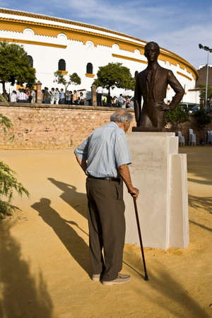 spanish looking: Man looking monument to the spanish bullfighter Manolete in Linares, Jaen province, Spain
