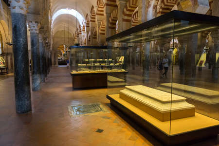 converted: CORDOBA, SPAIN - September, 27, 2015: Interior of Mezquita-Catedral, a medieval Islamic mosque that was converted into a Catholic Christian cathedral,  Cordoba, Spain Editorial
