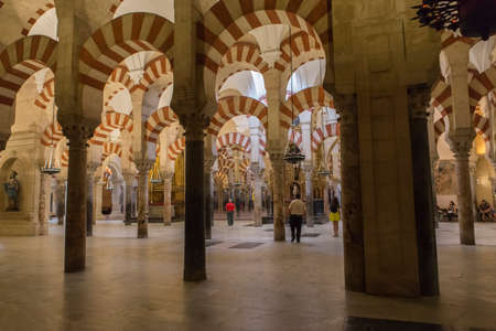 converted: CORDOBA, SPAIN - September, 27, 2015: Interior of Mezquita-Catedral, a medieval Islamic mosque that was converted into a Catholic Christian cathedral, Cordoba, Spain